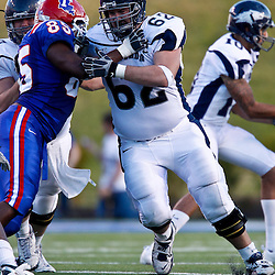 December 4, 2010; Ruston, LA, USA;  Nevada Wolf Pack offensive linesman John Bender (62) blocks Louisiana Tech Bulldogs defensive end Randy Grigsby (85) during the second half at Joe Aillet Stadium.  Nevada defeated Louisiana Tech 35-17. Mandatory Credit: Derick E. Hingle