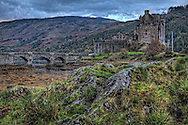 Eilean Donan Castle is located on the western side of Scotland near the hamlet of Dornie. This image was taken  on a cloudy  October day in the early morning hours.