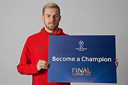 "CARDIFF, WALES - Friday, November 11, 2016: Wales' Aaron Ramsey holds up a board ""Become a Champion"" to encourage people to become volunteers for the 2017 UEFA Champions League Final in Cardiff. (Pic by David Rawcliffe/Propaganda)"