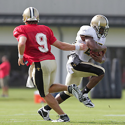 31 July 2009: New Orleans Saints quarterback Drew Brees (9) hands off to nrunning back Reggie Bush (25) during the opening day of New Orleans Saints training camp held at the team's practice facility in Metairie, Louisiana.