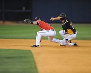 Mississippi's Kevin Mort (6) forces out Tennessee's Blake Forsythe (11) in a college baseball at Oxford-University Stadium on Friday, April 2, 2010 in Oxford, Miss. Ole Miss won 7-3.