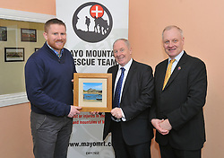 Jerome Hopkins Team Leader and Shane McGuire Chairman Mayo Mountain Rescue made a presentation to Minister of State Michel Ring TD at the official opening of Mayo Mountain Rescue's headquarters at Pinewoods last week.<br /> Pic Conor McKeown