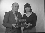 1980-02-19.19th February 1980.19-02-1980.02-19-80..The Bronze Cow:..Photographed at: location unspecified..Frank Flanagan, Chairman of National Dairy Council and Irene Cunningham, Ranks (I) Ltd,  admiring the Bronze Cow Trophy  due to be awarded at the Munster Dairy Farmer of the Year event. The trophy is tje work of Rowan Gillespie who is also responsible for the GAA All Star trophies.