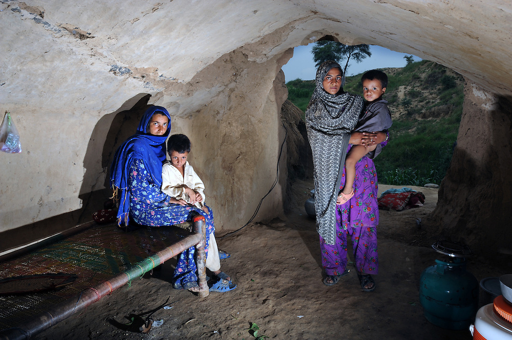 11/8/2009 Displaced people from Swat Bakhat Nazeera and Namro Gul with children Parwari  and Meer  in the cave in Haripur where they are staying until it is safe to return home. PHOTO KIM HAUGHTON