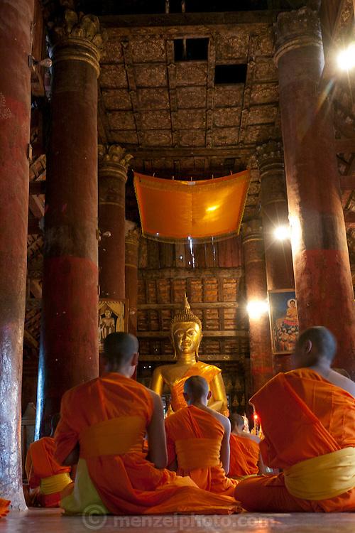 Wat Pak Khan, Luang Prabang, Laos. Evening chanting and prayers.