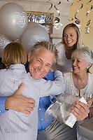 Senior man celebrating birthday with family