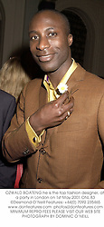 OZWALD BOATENG he is the top fashion designer, at a party in London on 1st May 2001.	ONL 83