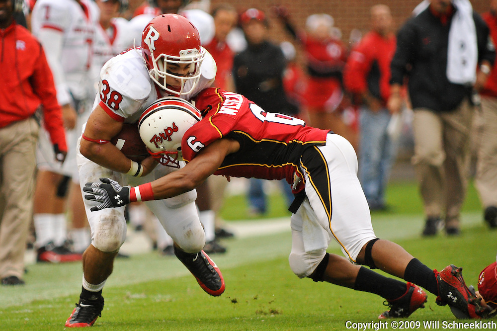 Sep 26, 2009; College Park, MD, USA; Rutgers running back Joe Martinek (38) is hit by Maryland defensive back Anthony Wiseman (6) during the first half of Rutgers' 34-13 victory over Maryland in NCAA college football at Byrd Stadium.