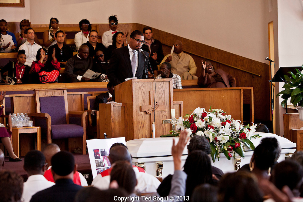 The pastor delivering remarks about Kevin.<br /> Funeral services for Kevin &quot;Flipside&quot; White at Macedonia Church in Watts.<br /> White was shot dead in what is believed to be an unprovoked attack during a gang conflict at Watts' Nickerson Gardens and Jordan Downs housing projects.<br /> Flipside, 44, was a founding member of Watts' first major label hip hop act, O.F.T.B. (Operation From The Bottom).