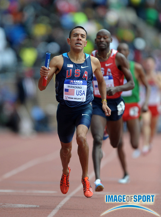 Apr 28, 2012; Philadelphia, PA, USA; Leonel Manzano holds off Bernard Lagat on the anchor of the USA vs The World distance medley relay, 9:19.31 to 9:19.88, in the 118th Penn Relays at Franklin Field.