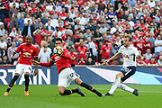 Harry Kane of Tottenham Hotspur shoots at goal past Manchester United Defender Chris Smalling during the The FA Cup Semi Final match between Manchester United and Tottenham Hotspur at Wembley Stadium, London, England on 21 April 2018. Picture by Phil Duncan.
