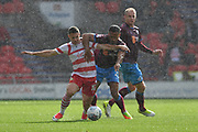 Doncaster Rovers midfielder Tommy Rowe (10) and Scunthorpe United defender Jordan Clarke (2)  during the EFL Sky Bet League 1 match between Doncaster Rovers and Scunthorpe United at the Keepmoat Stadium, Doncaster, England on 17 September 2017. Photo by Ian Lyall.