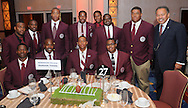 Morehouse College president Robert Franklin poses with members of his football team during the Paul Robeson Dinner at the AT&T Nation's Football Classic. (Photo by Alan Lessig)
