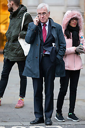 © Licensed to London News Pictures. 16/12/2019. London, UK. Shadow Chancellor of the Exchequer John McDonnell talks on the phone near Trafalgar Square .  Photo credit: George Cracknell Wright/LNP