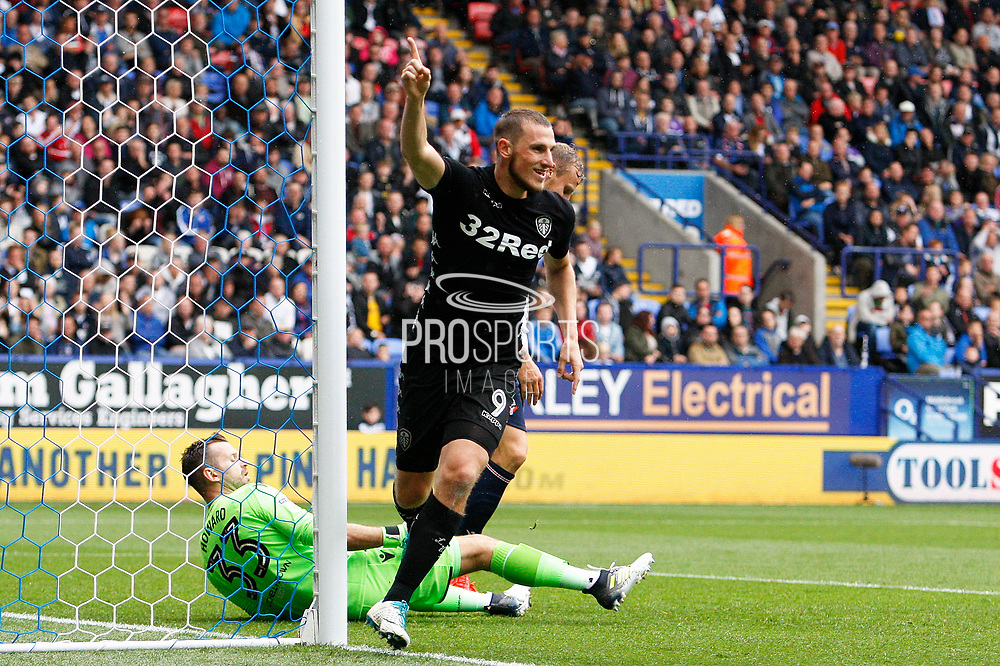 Leeds United Chris Wood (9) wheels away in celebration after scoring the second goal 0-2 during the EFL Sky Bet Championship match between Bolton Wanderers and Leeds United at the Macron Stadium, Bolton, England on 6 August 2017. Photo by Craig Galloway.