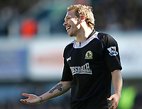 Photo: Lee Earle.<br /> Portsmouth v Blackburn Rovers. The Barclays Premiership. 08/04/2006. Blackburn's Craig Bellamy has a laugh with the ref.