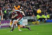 Hull City midfielder Mohammed Diame crosses ball past Burnley midfielder Joey Barton during the Sky Bet Championship match between Hull City and Burnley at the KC Stadium, Kingston upon Hull, England on 26 December 2015. Photo by Ian Lyall.