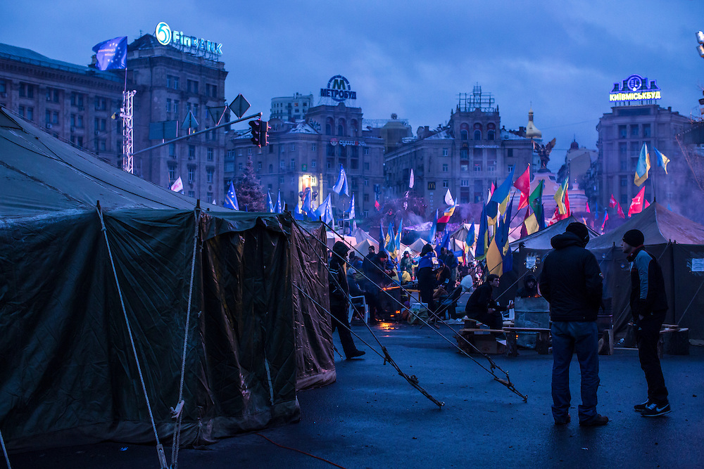 KIEV, UKRAINE - DECEMBER 8: Anti-government protesters camp on Independence Square early in the morning on December 8, 2013 in Kiev, Ukraine. Thousands of people have been protesting against the government since a decision by Ukrainian president Viktor Yanukovych to suspend a trade and partnership agreement with the European Union in favor of incentives from Russia. (Photo by Brendan Hoffman/Getty Images) *** Local Caption ***