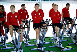 CARDIFF, WALES - Monday, September 3, 2018: Wales' David Brooks, Connor Roberts and Matthew Smith on warm-up bikes in the pre-activation tent during a training session at the Vale Resort ahead of the UEFA Nations League Group Stage League B Group 4 match between Wales and Republic of Ireland. (Pic by David Rawcliffe/Propaganda)
