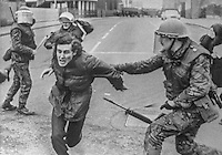 Army snatch squad in action outside a Belfast, N Ireland police station, 10th February 1973. Following an earlier People's Democracy protest march against sectarian killings some of the participants attacked the police station with bottles and stones. 197302100518<br />