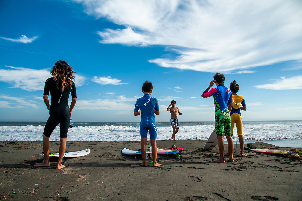 Young surfers prepare to enter the water at Kugenuma Beach in Fujisawa, Kanagawa Prefecture, 50 kilometers south of Tokyo.