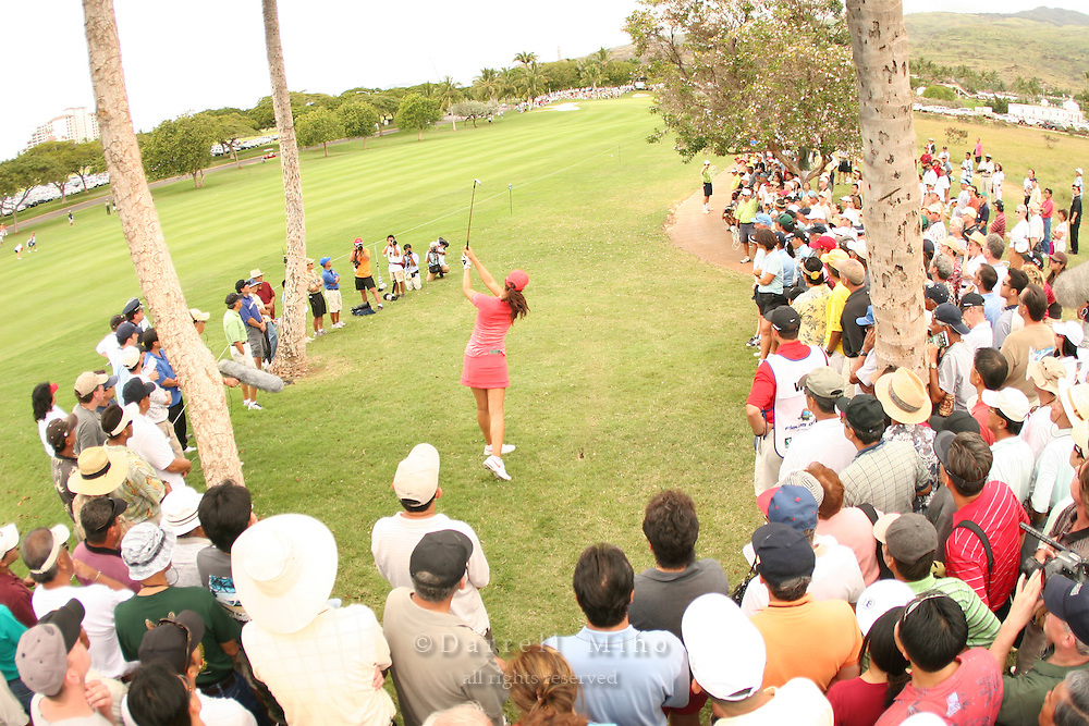 Feb 25, 2006; Kapolei, HI, USA; With a gallery looking on, Michelle Wie hits out of the rough during the final round at the inaugural LPGA Fields Open at Ko Olina Resort. ..Photo Credit: Darrell Miho .Copyright © 2006 Darrell Miho