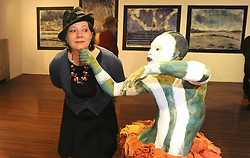 Westport Milliner Lena Stein engaging with Janet Mullarney Art pieces during the opening of the two group shows Identity and Ipseity at the Westival Gallery.<br /> Pic Conor McKeown