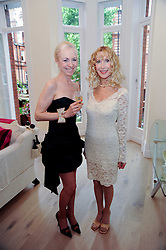Left to right, LADY BIENVENIDA BUCK and  BASIA BRIGGS at a reception to celebrate the repairs on the Queen Elizabeth Gate in Hyde Park after it's successful repair following damaged sustained in a traffic accident in early 2010.  The party was held at 35 Sloane Gardens, London on 7th June 2010.