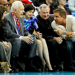 Dec 28, 2012; New Orleans, LA, USA; New Orleans Hornets and New Orleans Saints owner Tom Benson and wife Gayle Benson talks with New Orleans Archbishop Gregory Michael Aymond and suspended football coach Sean Payton courtside during the third quarter of a game at the New Orleans Arena. Mandatory Credit: Derick E. Hingle-USA TODAY Sports