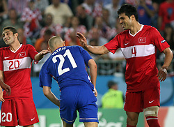 Sabri Sarioglu of Turkey, Mladen Petric of Croatia and Gokhan Zan during at the UEFA EURO 2008 Quarter-Final soccer match between Croatia and Turkey at Ernst-Happel Stadium, on June 20,2008, in Wien, Austria. Turkey won after penalty shots. (Photo by Vid Ponikvar / Sportal Images)