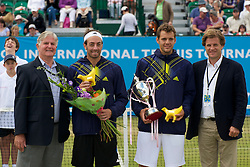 LIVERPOOL, ENGLAND - Saturday, June 19, 2010: Men's Champion Paul-Henri Mathieu (FRA) with Nicolas Massu (CHI) and Referee Alan Mills and Tournament Director Anders Borg after the Men's Singles Final on day four of the Liverpool International Tennis Tournament at Calderstones Park. (Pic by David Rawcliffe/Propaganda)