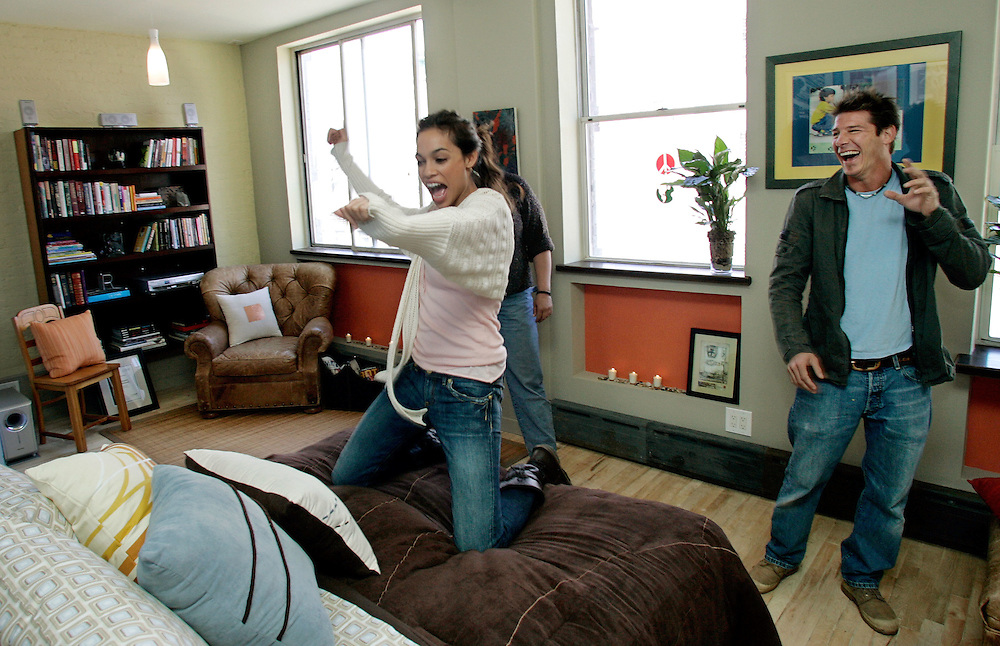 Ty Pennington and Rosario Dawson during a promotional filming of Extreme Home-Makeover at Dawson's apartment in the East Village of Manhattan, April 9, 2005. (Photo - Stuart Ramson)
