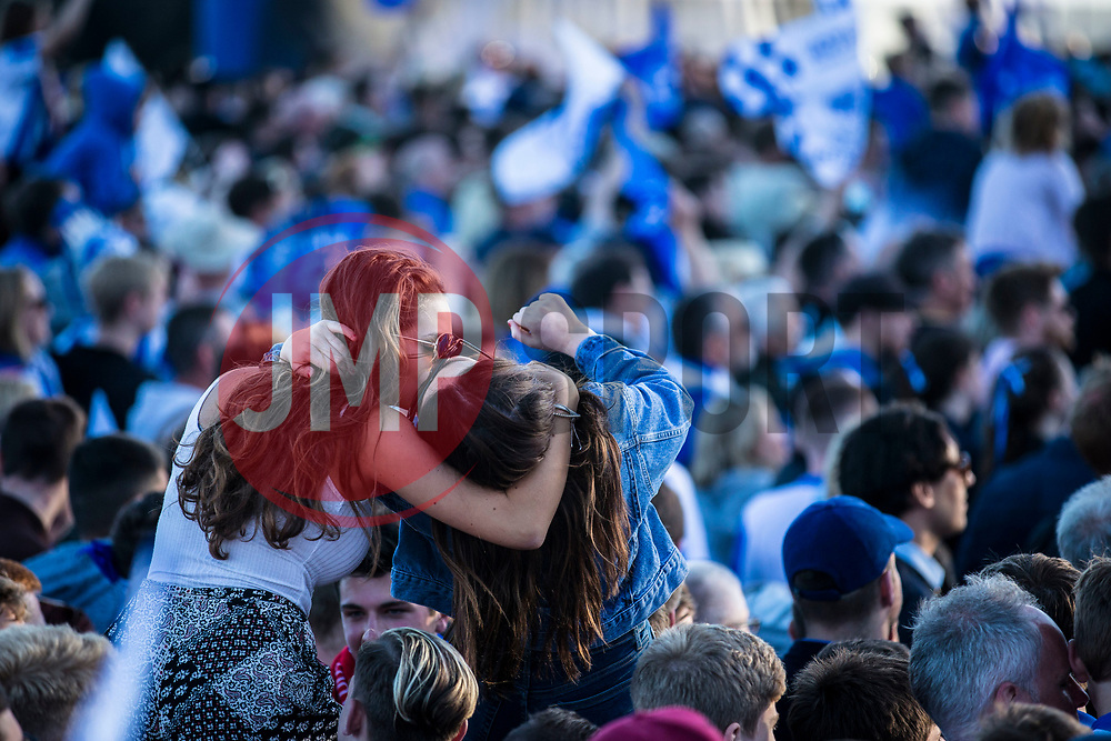 A couple of Brighton & Hove Albion fans celebrate at the Premier League Promotion Parade - Mandatory by-line: Jason Brown/JMP - 14/05/17 - FOOTBALL - Brighton and Hove Albion, Sky Bet Championship 2017 - Brighton and Hove Albion Promotion Parade