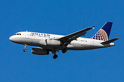 United Airlines Airbus A319-131 (registration N803UA) approaches San Francisco International Airport (SFO) over San Mateo, California, United States of America