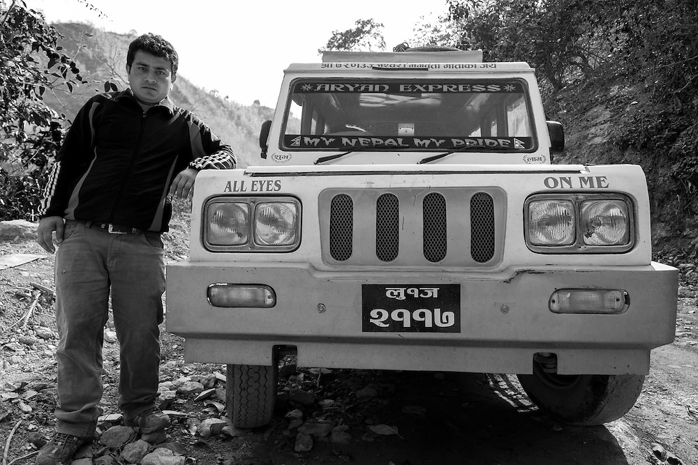 A driver for hire poses with his Mahindra truck on the road to Ranighat Durbar