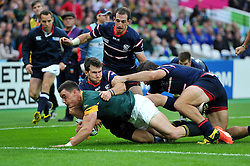 Jesse Kriel of South Africa reaches for the try-line - Mandatory byline: Patrick Khachfe/JMP - 07966 386802 - 07/10/2015 - RUGBY UNION - The Stadium, Queen Elizabeth Olympic Park - London, England - South Africa v USA - Rugby World Cup 2015 Pool B.