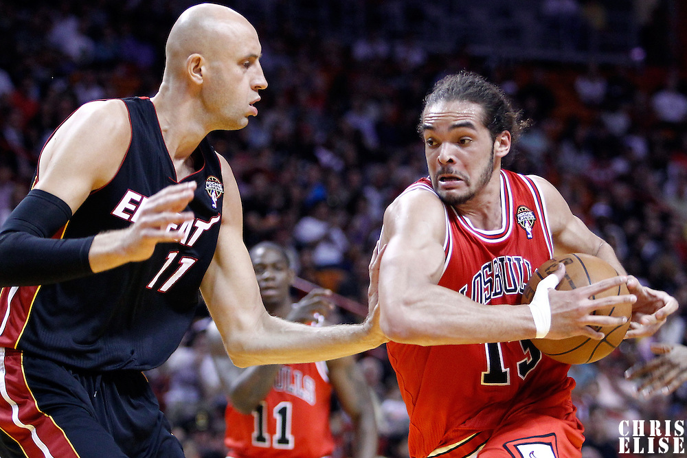 06 March 2010: Chicago Bulls center Joakim Noah (13) drives past Miami Heat center Zydrunas Ilgauskas (11) during the Chicago Bulls 87-86 victory over the Miami Heat at the AmericanAirlines Arena, Miami, Florida, USA.