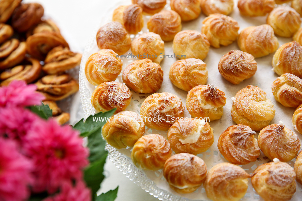Cream Puffs (Eclairs) on a buffet table