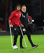 Nathan Ake (5) of AFC Bournemouth who picked up an injury, on crutches as he walk across the pitch at the end of the match during the Premier League match between Bournemouth and Liverpool at the Vitality Stadium, Bournemouth, England on 7 December 2019.