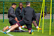 Uche Ikpeazu(#19) of Heart of Midlothian jokes with Jake Mulraney(#23) of Heart of Midlothian during training at the Oriam Sports Performance Centre, Edinburgh on 13 September 2018, ahead of the away match against Motherwell.