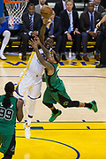 Golden State Warriors forward Draymond Green (23) blocks a lay up attempt by Boston Celtics guard Isaiah Thomas (4) at Oracle Arena in Oakland, Calif., on March 8, 2017. (Stan Olszewski/Special to S.F. Examiner)