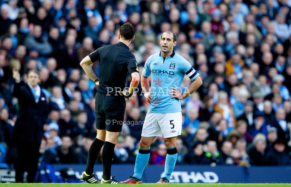 MANCHESTER, ENGLAND - Sunday, February 17, 2013: Manchester City's captain Pablo Zabaleta talks to referee Mark Clattenburg during the FA Cup 5th Round match against Leeds United at the City of Manchester Stadium. (Pic by Vegard Grott/Propaganda)