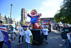 © Licensed to London News Pictures. 19/10/2019. London, UK. An effigy of DOMINIC CUMMINGS using British Prime Minister BORIS JOHNSON as a puppet, is seen outside The Houses of Parliament in Westminster, London on the day that Parliament will vote on a new agreement between UK government and the EU over Brexit. Parliament is sitting on a Saturday for the first time since 1982. Photo credit: Ben Cawthra/LNP