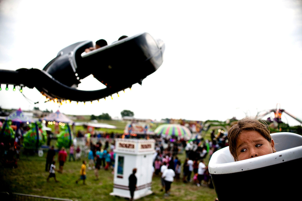 A young girl looks back while riding the Tornado at the annual Rosebud Fair and Wacipi in Rosebud, South Dakota Aug. 21, 2013. Photo by Lauren Justice
