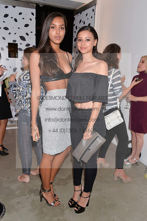 Left to right, ARLISSA and LEAH WELLER at the launch of The Lulu Perspective to celebrate 25 years of Lulu Guinness held at 74a Newman Street, London on 13th September 2014.