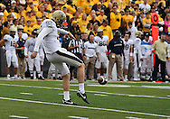 September 17, 2011: Pittsburgh Panthers punter Matt Yoklic (92) punts the ball away during the first half of the game between the Iowa Hawkeyes and the Pittsburgh Panthers at Kinnick Stadium in Iowa City, Iowa on Saturday, September 17, 2011. Iowa defeated Pittsburgh 31-27.