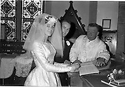 28/07/1962<br /> 07/28/1962<br /> 28 July 1962 <br /> Wedding of Mr Desmond F. English, Landscape Cresent, Churchtown and Miss Blanche O'Brien Oakley Park, Blackrock at St John the Baptist Church, Blackrock and Ross's Hotel Dun Laoghaire, Dublin. Image shows the bride and groom signing the register  after the ceremony.