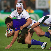 Oaul Williams, Samoa, is tackled by Heinrich Brussow, South Africa, during the South Africa V Samoa, Pool D match during the IRB Rugby World Cup tournament. North Harbour Stadium, Auckland, New Zealand, 30th September 2011. Photo Tim Clayton...