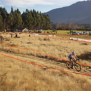 Dan Warren from Hastings on his way to victory in the New Zealand Cyclocross Championships sponsored by AJ Hackett Bungy, held at Jardine Park,  Queenstown, as part of the Queenstown WInter Festival.  Anja McDonald from Dunedin won the women's event. Queenstown, New Zealand, 2nd July 2011