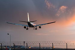 Heathrow Airport, London, March 28th 2016. A British Airbus A330 lands as the setting sun illuminates the clouds left behind as departing Storm Katie drifts eastwards at London Heathrow.